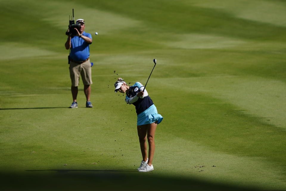 Nelly Korda of the U.S. hits on the fairway of the 16th hole during the final round of play in the KPMG Women's PGA Championship golf tournament, Sunday, June 27, 2021, in Johns Creek, Ga. (AP Photo/John Bazemore)