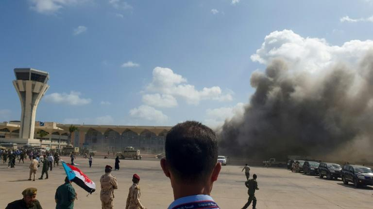 Smoke clouds billowed into the air after explosions at Yemen's Aden airport on December 30, 2020, shortly after the arrival of a plane carrying members of a new unity government