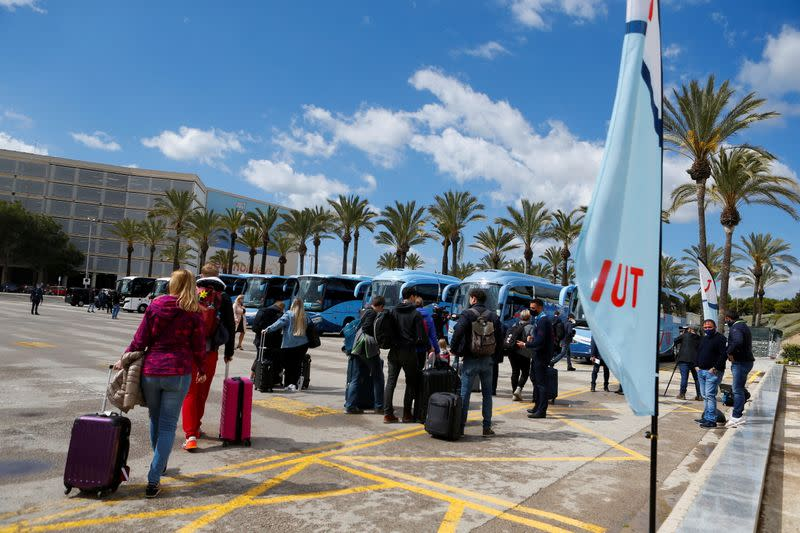 Tourists from Germany arrive at Palma de Mallorca Airport