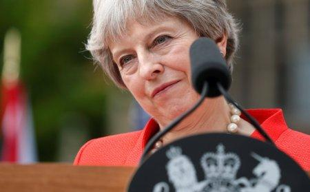 British Prime Minister Theresa May listens as she and U.S. President Donald Trump hold a press conference after their meeting at Chequers in Buckinghamshire, Britain July 13, 2018. REUTERS/Kevin Lamarque