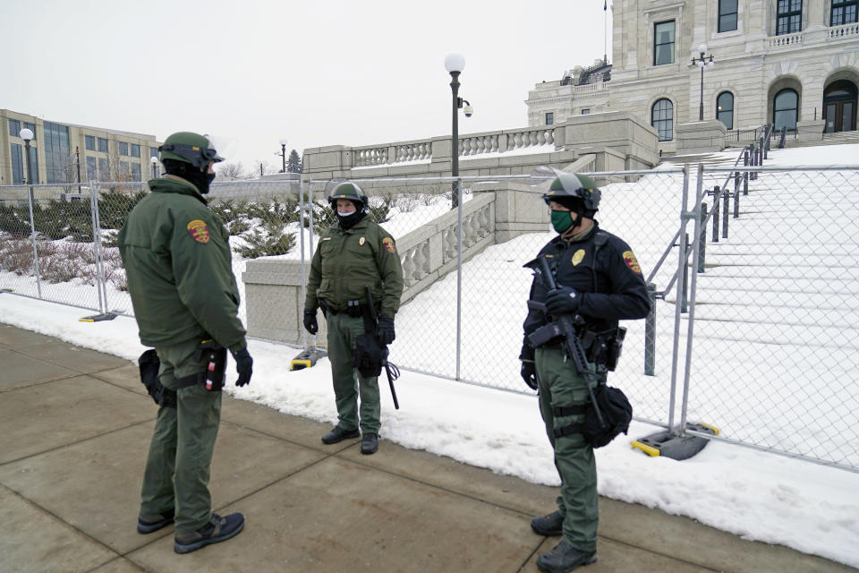 Minnesota Law Enforcement officers protect the Minnesota State Capitol Thursday, Jan. 7, 2021 in St. Paul, Minn., in the wake of the Electoral College protests Wednesday at the U.S. Capitol in Washington, D.C. Statehouses where Trump loyalists have rallied since the Nov. 3 election are heightening security after the storming of the U.S. Capitol this week. Police agencies in a number of states are monitoring threats of violence as legislatures return to session and as the nation prepares for the inauguration of President-elect Joe Biden. (AP Photo/Jim Mone)