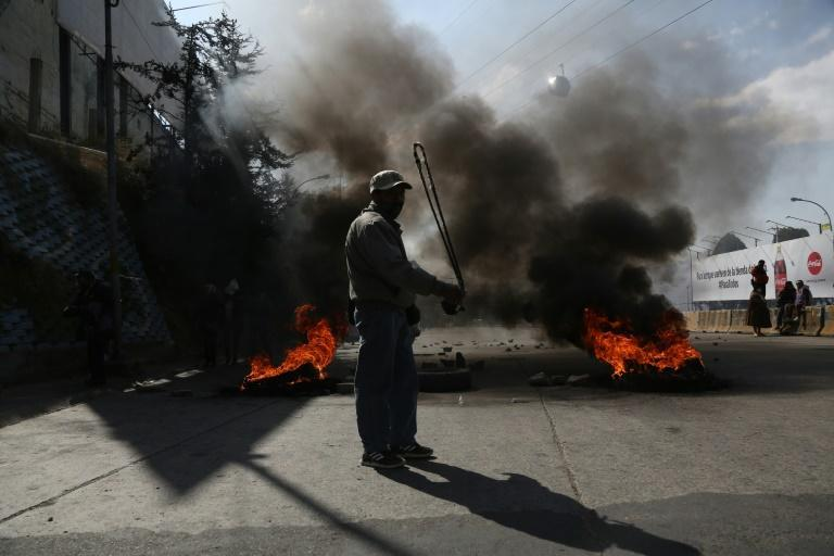 A supporter of Bolivian ex-president Evo Morales is seen protesting at a blockade in El Alto on August 10, 2020