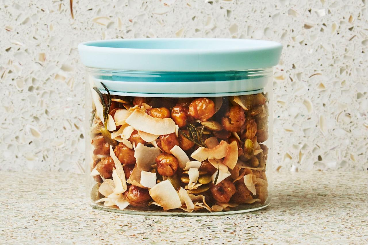 """The beauty of this mix is that it can be deployed lots of ways. Eat it out of hand, or spoon it over plain yogurt as a savory topping. <a href=""""https://www.epicurious.com/recipes/food/views/coconut-and-crispy-chickpea-trail-mix?mbid=synd_yahoo_rss"""">See recipe.</a>"""