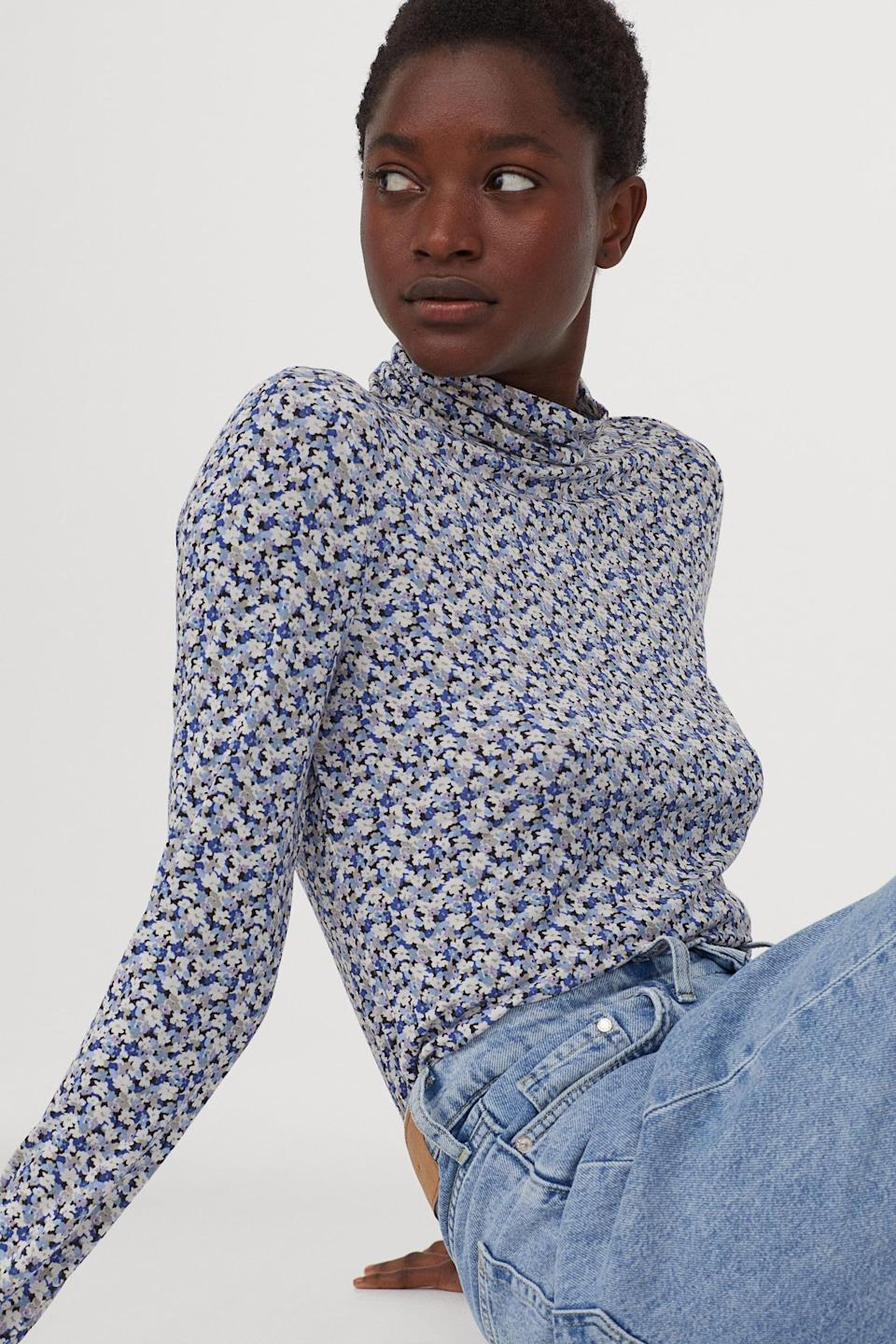 <p>You can never go wrong with a <span>Jersey Turtleneck Top</span> ($10)</p>