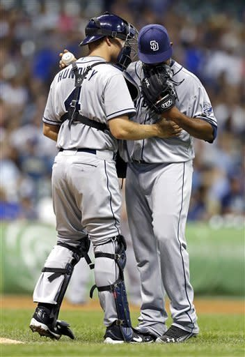 San Diego Padres' Nick Hundley, left, talks with Edinson Volquez after Volquez gave up a home run and a double to the Milwaukee Brewers in the fifth inning of a baseball game Friday, June 8, 2012, in Milwaukee. (AP Photo/Tom Lynn)