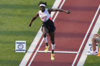 Will Claye competes during the finals of men's triple jump at the U.S. Olympic Track and Field Trials Monday, June 21, 2021, in Eugene, Ore. (AP Photo/Charlie Riedel)