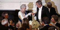 <p>The queen and President George W. Bush toasted their glasses at a white-tie state dinner held at the White House. </p>