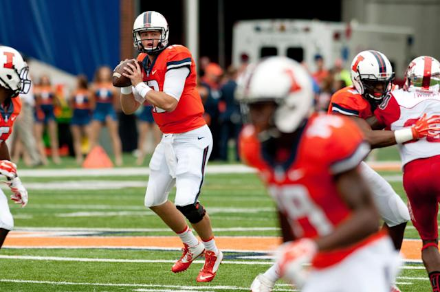 Illinois quarterback Wes Lunt (12) looks to pass during the first quarter of an NCAA college football game against Western Kentucky, Saturday, Sept. 6, 2014, at Memorial Stadium in Champaign, Ill. (AP Photo/Bradley Leeb)