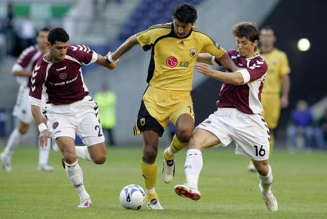Watford manager Vladimir Ivic, centre, playing for AEK Athens against Hearts in a Champions League third qualifying round match at Murrayfield