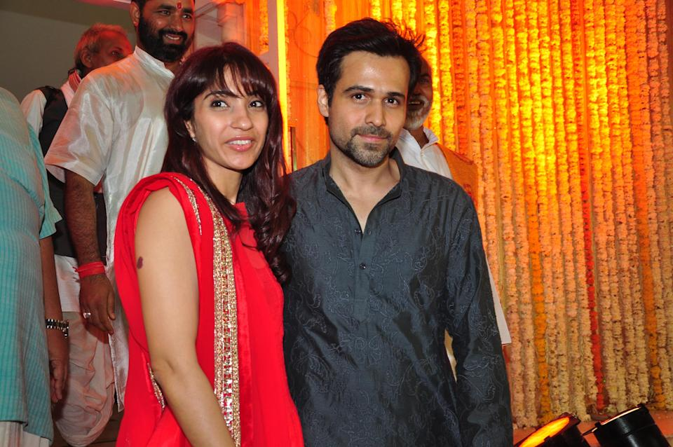 MUMBAI, INDIA - JANUARY 29: Indian actor Emraan Hashmi with wife Parveen Shahani during Mohit Suri and Udita Goswami's wedding ceremony at Iscon Temple, Juhu on January 29, 2013 in Mumbai, India. (Photo by Amlan Dutta/Hindustan Times via Getty Images)