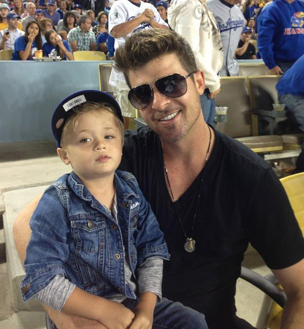 Robin Thicke loves to hang with his mini-me, Julian. (Photo: Los Angeles Dodgers via Getty Images)