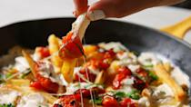 """<p>When it comes to pizza and fries, now you don't have to choose!</p><p>Get the recipe from <a href=""""https://www.delish.com/cooking/recipe-ideas/recipes/a47874/margherita-pizza-fries/"""" rel=""""nofollow noopener"""" target=""""_blank"""" data-ylk=""""slk:Delish"""" class=""""link rapid-noclick-resp"""">Delish</a>.</p>"""