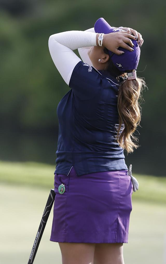 Lizette Salas celebrates winning the Kingsmill Championship golf tournament at the Kingsmill resort in Williamsburg, Va., Sunday, May 18, 2014. Salas won her first LPGA event after shooting an even par-71 leaving her at 13-under for the tournament. (AP Photo/Steve Helber)