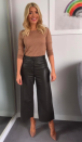 """<p>We need a pair of Holly's leather trousers, asap. And luckily, the L.K Bennett khaki <a rel=""""nofollow noopener"""" href=""""https://www.lkbennett.com/product/CTLULALAMBSKINGreenForest~Lula-Forest-Leather-Trouser-Forest?gclid=EAIaIQobChMI8qqBrJSg1wIV6pPtCh3cQwPAEAQYASABEgJr_PD_BwE"""" target=""""_blank"""" data-ylk=""""slk:numbers"""" class=""""link rapid-noclick-resp"""">numbers</a> are still available. She finished the look with a caramel-hued knit by J Crew. </p>"""