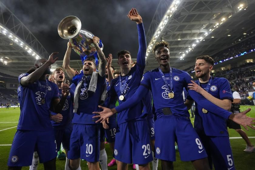 Chelsea's Christian Pulisic celebrates with the trophy after winning the Champions League final soccer match between Manchester City and Chelsea at the Dragao Stadium in Porto, Portugal, Saturday, May 29, 2021. (AP Photo/Manu Fernandez, Pool)