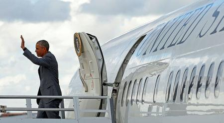 U.S. President Barack Obama waves as he steps out of Air Force One upon his arrival in Miami