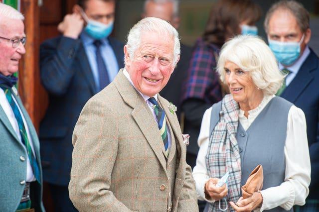 Prince of Wales and the Duchess of Cornwall, known as the Duke and Duchess of Rothesay when in Scotland, on a walk through the village during a visit to the Ballater Community & Heritage Hub in Ballater, Aberdeenshire (Wullie Marr/DCT Media/PA)