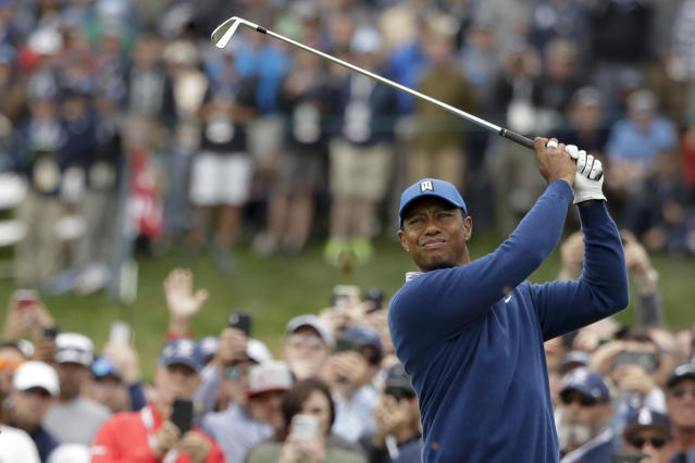 Tiger Woods watches his tee shot on the fourth hole during the second round of the U.S. Open golf tournament Friday, June 14, 2019, in Pebble Beach, Calif. (AP Photo/Marcio Jose Sanchez)