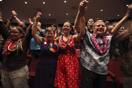 People celebrate after Hawaii Governor Abercrombie signed Senate Bill 1, allowing same sex marriage to be legal in the state, in Honolulu, Hawaii