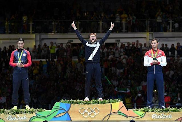 """(L-R) Silver medalist US Alexander Massialas, gold medalist Italy's Daniele Garozzo, and bronze medalist Russia's <a class=""""link rapid-noclick-resp"""" href=""""/olympics/rio-2016/a/1087915/"""" data-ylk=""""slk:Timur Safin"""">Timur Safin</a> (KIRILL KUDRYAVTSEV/AFP/Getty Images)"""