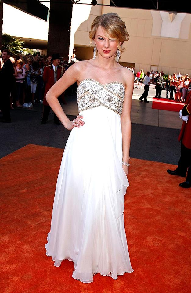 """18-year-old Taylor Swift was prettier than a princess in her gorgeous strapless gown and sophisticated jewelry. Kevin Winter/<a href=""""http://www.gettyimages.com/"""" target=""""new"""">GettyImages.com</a> - May 18, 2008"""