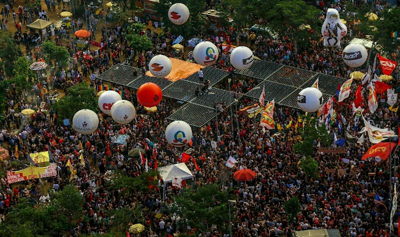 People take part in a demonstration against the Brazilian government's plan to slash education spending, in Sao Paulo (AFP Photo/Miguel SCHINCARIOL)
