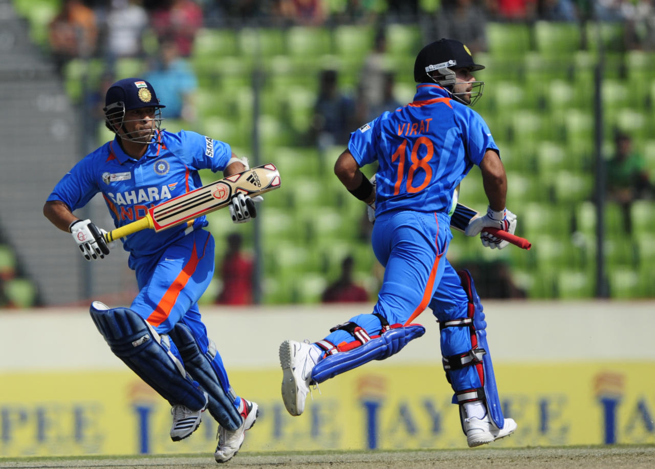 Indian batsman Sachin Tendulkar (L) and his teammate Virat Kohli (R) runs between the wickets during the one day international (ODI) Asia Cup cricket match between India and   Bangladesh at The Sher-e-Bangla National Cricket Stadium in Dhaka on March 16, 2012.