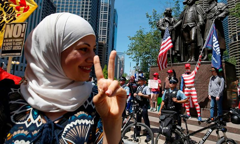 "An activist takes part in a rally against demonstrators at a ""March against sharia"" protest in Chicago."