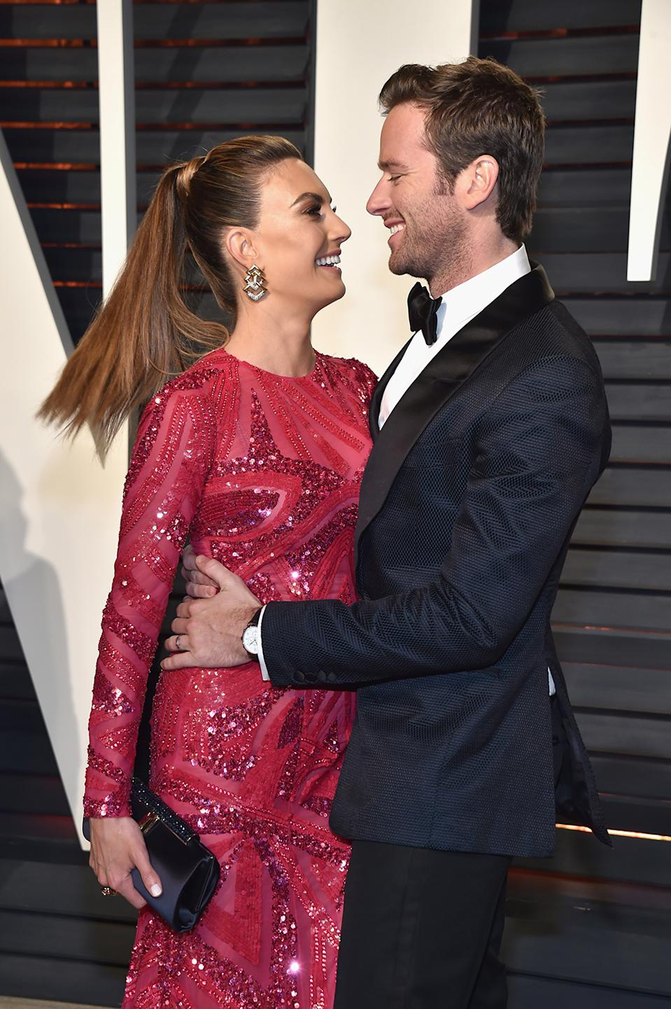 Armie Hammer and Elizabeth Chambers pose on the red carpet