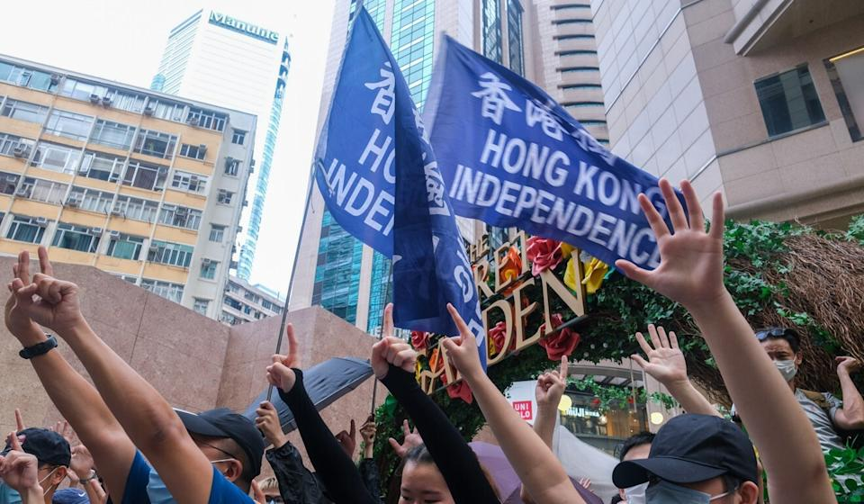 Protesters hold flags that read 'Hong Kong Independence' during a protest in Causeway Bay district, in Hong Kong, China, on Wednesday, July 1, 2020. Photo: Bloomberg