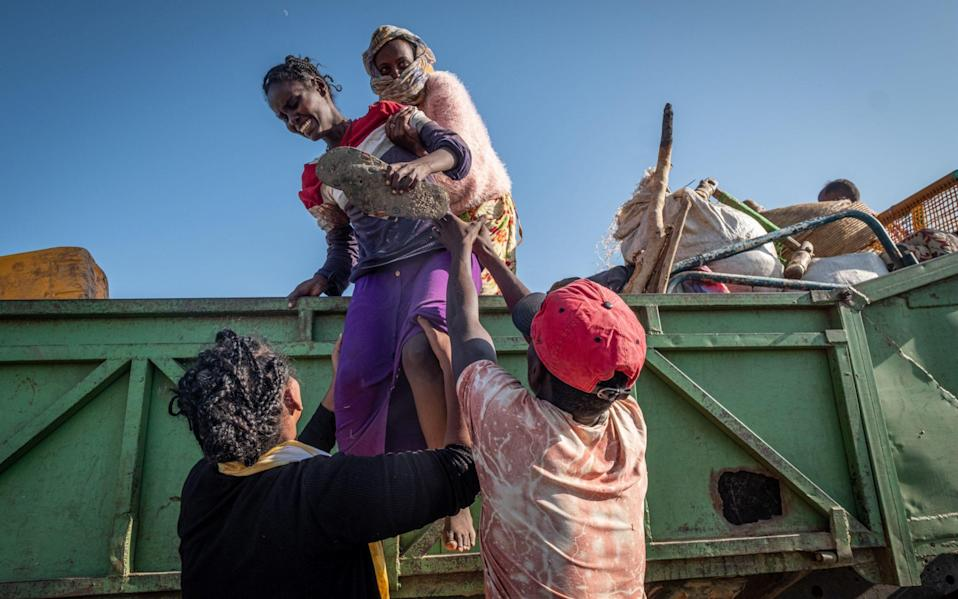 An Ethiopian woman cries as she arrives in a refugee camp in Sudan, fleeing the horrendous civil war at the other side of the border. - Joost Bastmeijer for the Telegraph