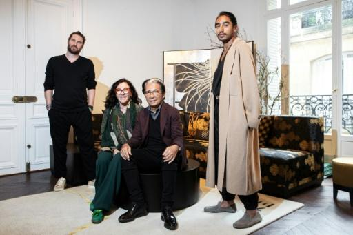 Kenzo with his design team in his Paris studio