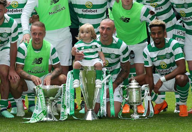Soccer Football - Celtic vs Ireland XI - Scott Brown Testimonial - Celtic Park, Glasgow, Britain - May 20, 2018 Celti's Scott Brown poses with team mates, a child and their trophies Action Images via Reuters/Jason Cairnduff