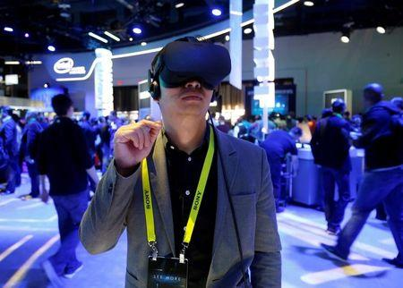 Summer Tan of China tries out a Oculus Rift virtual reality headset at the Intel booth during the 2017 CES in Las Vegas