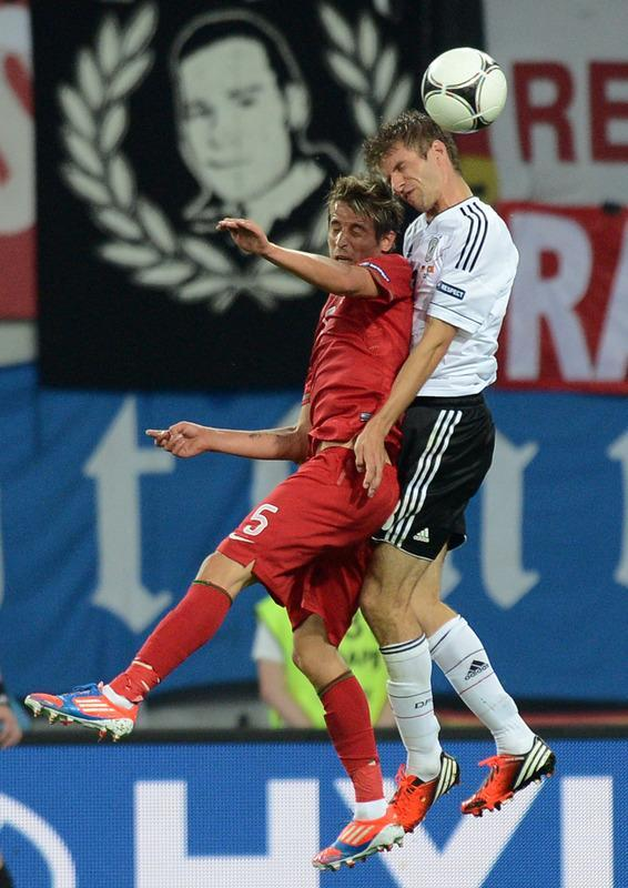 Portuguese defender Fabio Coentrao (L) vies with German forward Thomas Mueller during the Euro 2012 championships football match Germany vs Portugal on June 9, 2012 at the Arena Lviv. AFP PHOTO / JEFF PACHOUDJEFF PACHOUD/AFP/GettyImages