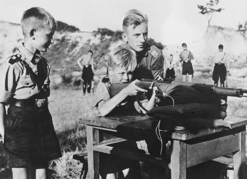 Eleven-year-old boys in the Hitler Youth organization learning how to fire a rifle. | Keystone—Getty Images