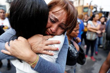 Relatives of inmates react outside a detention center of the Bolivarian National Intelligence Service, where a riot occurred according to relatives in Caracas