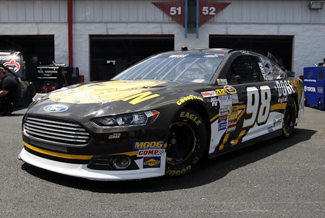 Driver Josh Wise pulls out of the garage during practice for Sunday's Aaron's 499 NASCAR auto race at Talladega Superspeedway on Friday, May 2, 2014, in Talladega, Ala. (AP Images Photo/Butch Dill)