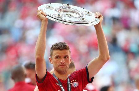 FILE PHOTO: Soccer Football - Bundesliga - Bayern Munich v VfB Stuttgart - Allianz Arena, Munich, Germany - May 12, 2018 Bayern Munich's Thomas Mueller celebrates winning the Bundesliga with the trophy REUTERS/Michael Dalder