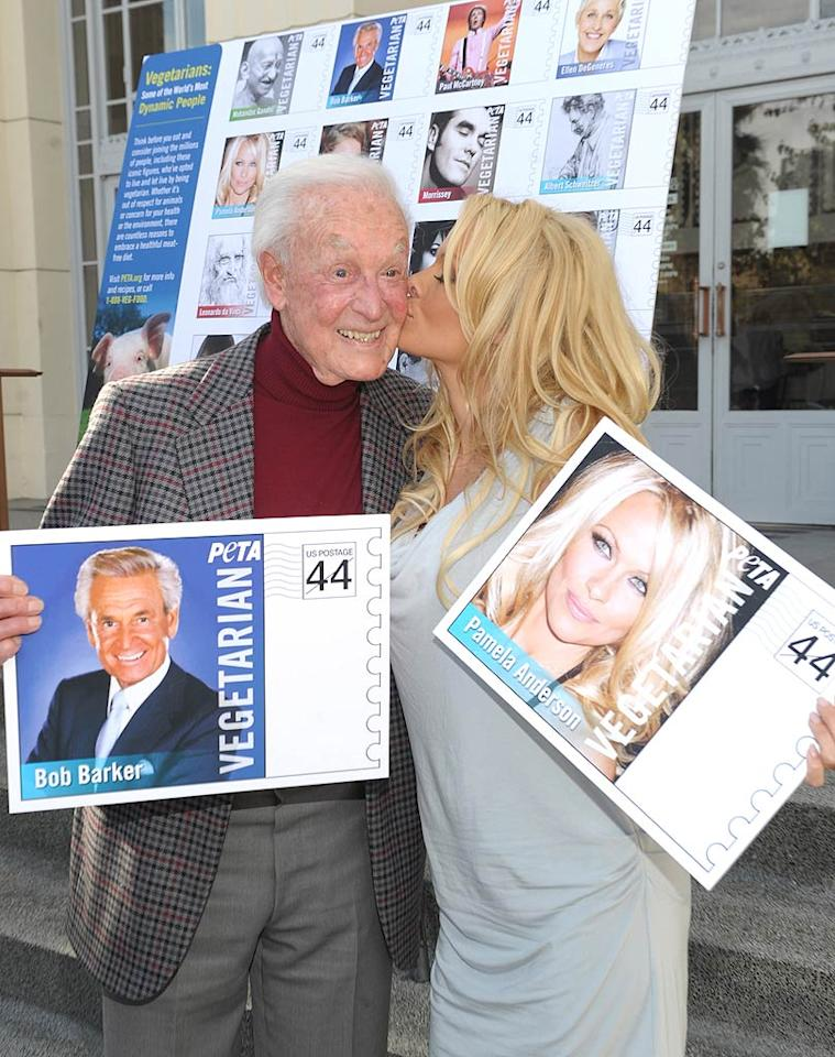 "You might think that fabled game show host Bob Barker and buxom former ""Baywatch"" babe Pamela Anderson don't have all that much in common, but the two are both serious animal advocates! Bob and Pam came together for a smooch at at the Hollywood Post Office on Tuesday for the unveiling of the Vegetarian Icons Postage Sheet featuring famous vegetarians. (11/29/2011)"