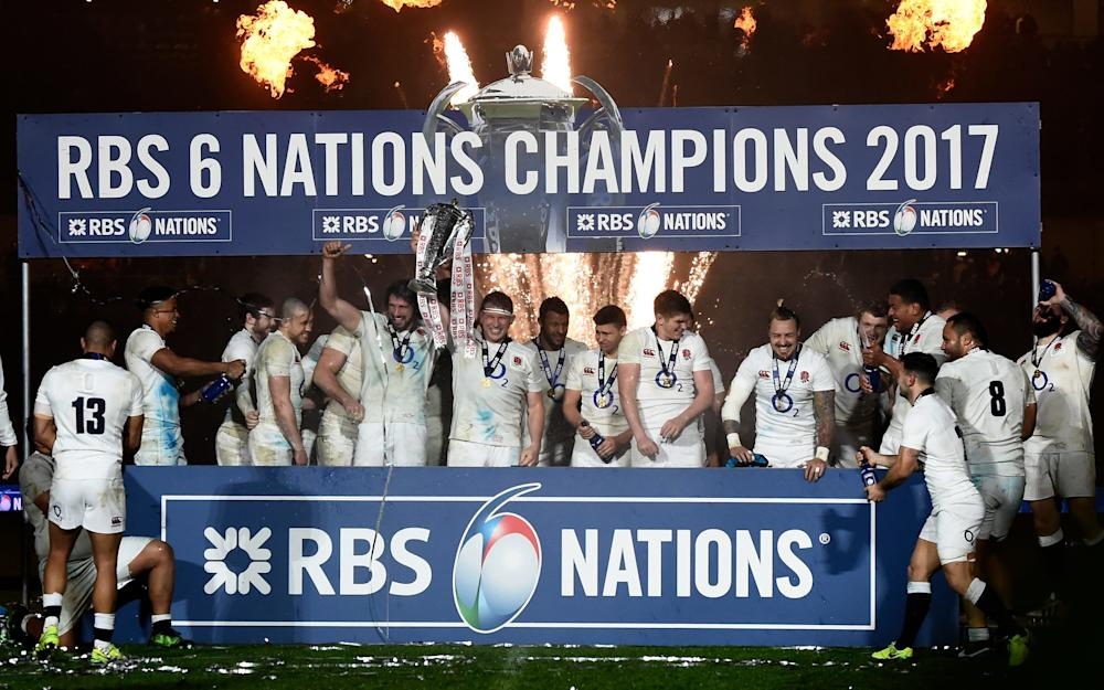 England celebrate with the Six Nations trophy - Credit: REUTERS