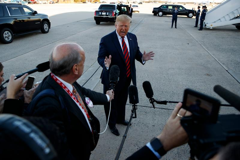 Donald Trump speaks to reporters before boarding Air ForceOne at Andrews Air Force Base in Maryland: AP