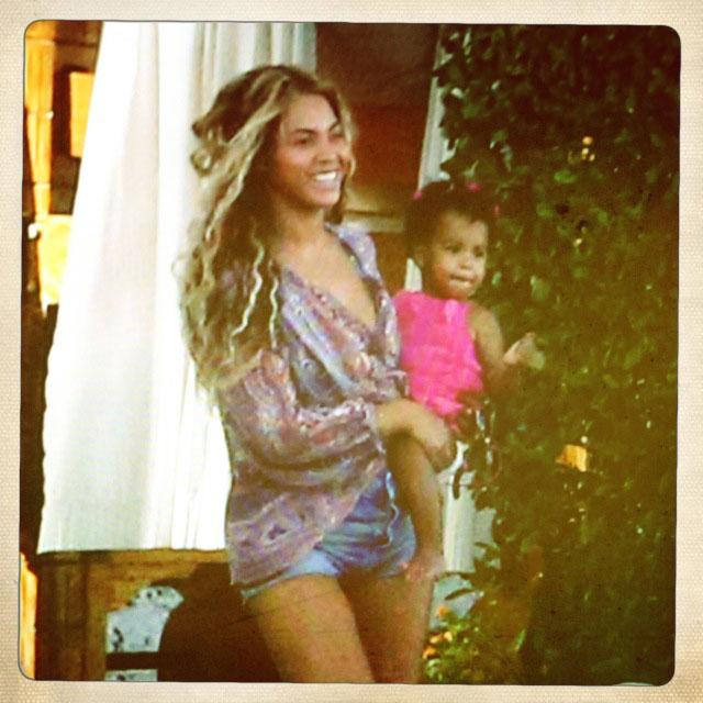 Beyonce holds her baby girl tight during a family vacation.