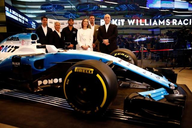 Israeli racing driver Roy Nissany, Williams deputy team principal Claire Williams, Sylvan Adams and Chemi Peres pose for a photo after Nissany signed with British Formula One motor racing team Williams in Tel Aviv