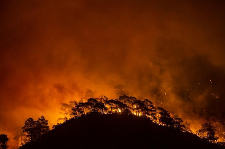 Marmaris on the Aegean Sea saw flames simmer across the crests of forest-covered hills as Turkey fights deadly wildfires