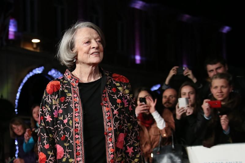 Dame Maggie Smith poses for photographers upon arrival at the premiere of the film 'The Lady In The Van', as part of the London film festival in London, Tuesday, Oct. 13, 2015. (Photo by Joel Ryan/Invision/AP)