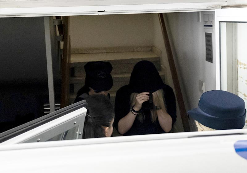 A British teenager who accused seven Israelis of gang rape covers her face with a hood as she leaves the Famagusta District Court in Paralimni in eastern Cyprus, after a hearing session on August 27, 2019. - Initially, the 19-year-old woman had alleged that 12 Israelis gang raped her at the hotel where she was staying in the popular Ayia Napa resort on July 17. (Photo by Iakovos Hatzistavrou / AFP) (Photo credit should read IAKOVOS HATZISTAVROU/AFP/Getty Images)