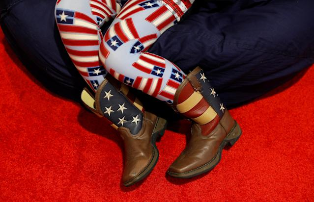 <p>A young girl wears patriotic boots and leggings at the Conservative Political Action Conference (CPAC) at National Harbor, Md., Feb. 22, 2018. (Photo: Kevin Lamarque/Reuters) </p>