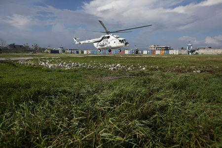 The helicopter transporting UN Secretary General Ban Ki Moon takes off from MINUSTAH base at the end of a visit after Hurricane Matthew in Les Cayes, Haiti, October 15, 2016. REUTERS/Andres Martinez Casares