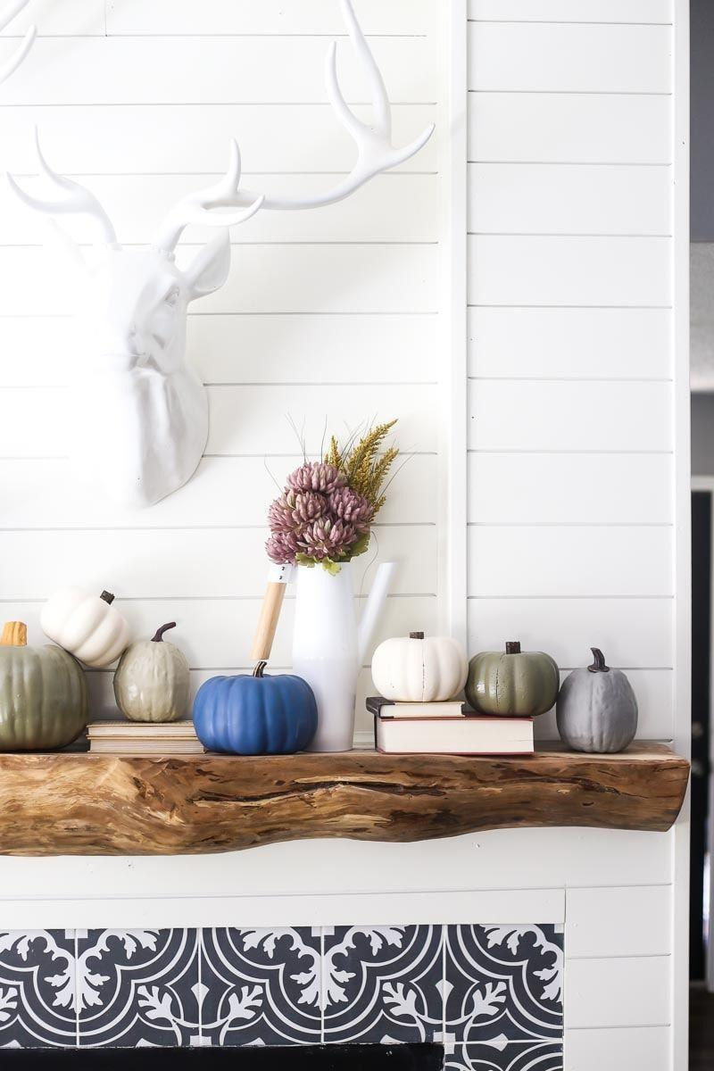 """<p>For a neutral color palette for your mantel décor, look no further than these painted pumpkins in soft hues. </p><p><strong>Get the tutorial at <a href=""""https://www.loveandrenovations.com/painted-faux-pumpkins/"""" rel=""""nofollow noopener"""" target=""""_blank"""" data-ylk=""""slk:Love & Renovations"""" class=""""link rapid-noclick-resp"""">Love & Renovations</a>.</strong></p><p><a class=""""link rapid-noclick-resp"""" href=""""https://go.redirectingat.com?id=74968X1596630&url=https%3A%2F%2Fwww.walmart.com%2Fip%2FKILZ-Chalk-Style-Decorative-Paint-for-Upcycling-Furniture%2F621605214%3FvariantFieldId%3Dactual_color&sref=https%3A%2F%2Fwww.thepioneerwoman.com%2Fhome-lifestyle%2Fcrafts-diy%2Fg36891743%2Ffall-mantel-decorations%2F"""" rel=""""nofollow noopener"""" target=""""_blank"""" data-ylk=""""slk:SHOP CHALKED SPRAY PAINT"""">SHOP CHALKED SPRAY PAINT</a></p>"""